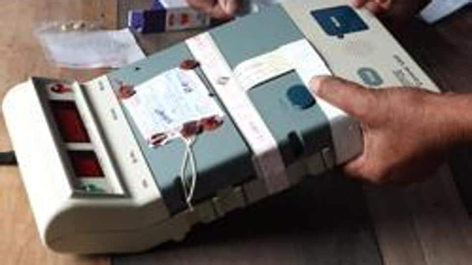 An Election Commission official seals an Electronic Voting Machine (EVM).