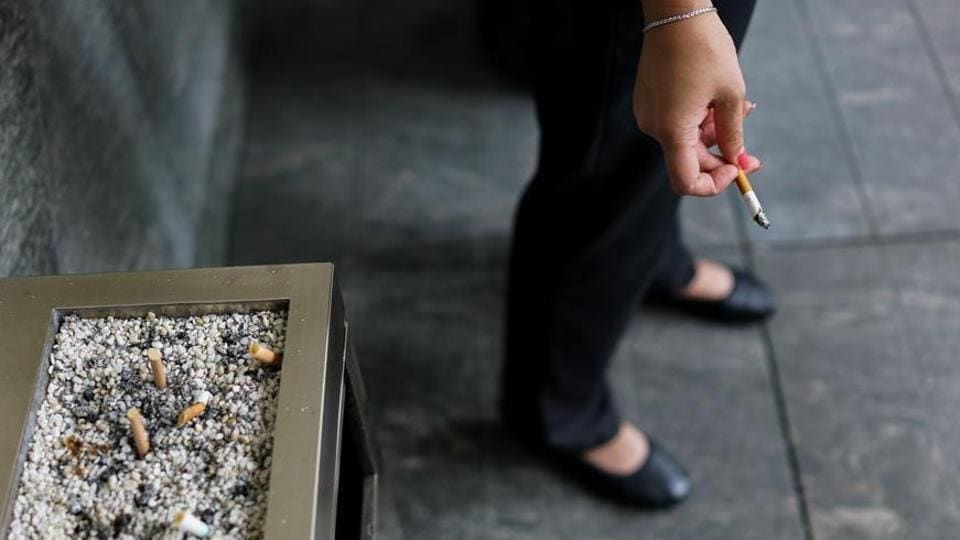 The woman said a man abused her for smoking and tried to snatch her cigarette.