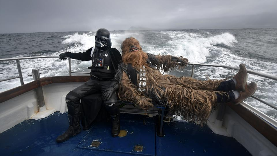 Darth Vader and Chewbacca take a boat trip to the Skelligs where the first ever Star Wars festival is taking place in Portmagee, Ireland. Skellig Michael island was used extensively in Episode VII and Episode VIII of the popular science fiction saga. (Charles McQuillan / Getty Images)