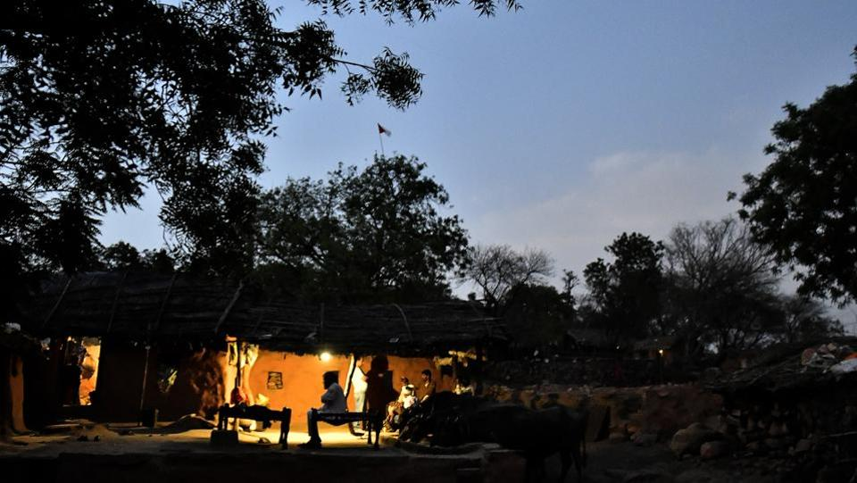 A scene outside a home in Kraska at dusk. Former officials of the reserve and forest have said that the prolonged delays in the relocation and repopulating efforts are working to Sariska's detriment as a sanctuary for tigers and also as a competitor to Ranthambore for wildlife tourism. (Anindito Mukherjee / Bloomberg)