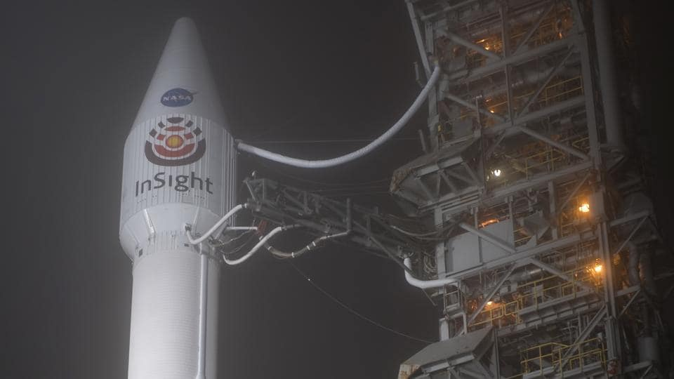 This photo released by NASA shows a United Launch Alliance (ULA) Atlas-V rocket with NASA's InSight spacecraft onboard shortly after the mobile service tower was rolled back, Friday, May 4, 2018, at Vandenberg Air Force Base in Calif. The rocket is set to launch early Saturday. (Bill Ingalls/NASA via AP))