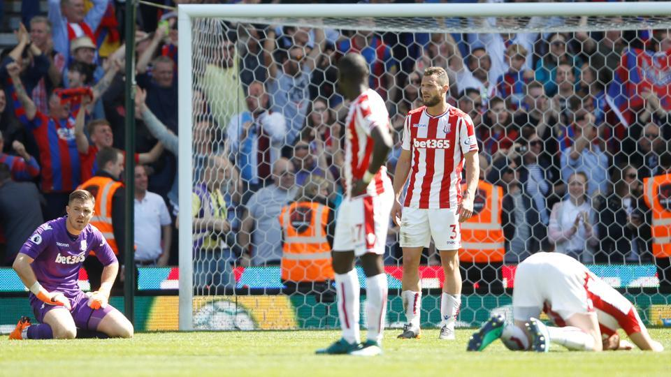 Stoke City players react to conceding a late goal from Crystal Palace that confirmed their relegation from the Premier League.