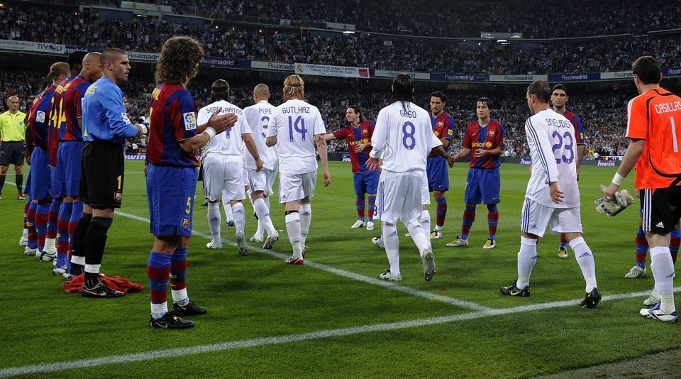 Barcelona players form a guard of honour for La Liga champions Real Madrid before the start of the La Liga match between Real Madrid and Barcelona at the Santiago Bernabeu stadium on May 7, 2008 in Madrid. Real have declined Barcelona a guard of honour this time around.