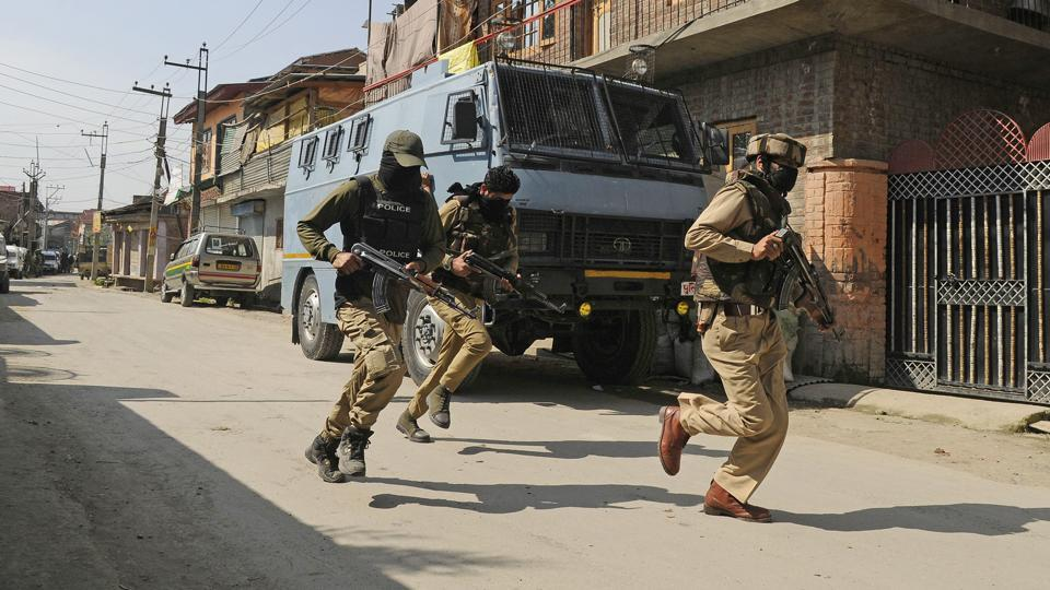 Securitymen take positions as an encounter rages with terrorists in Chattabal area of Srinagar on May 5.