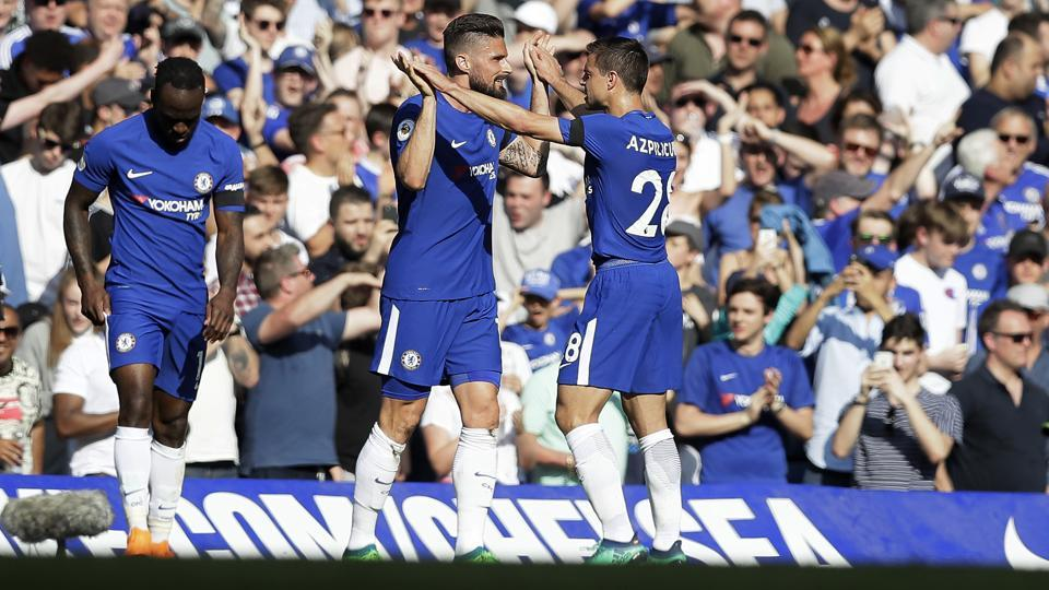 Chelsea's Olivier Giroud, center, celebrates with his teammate Cesar Azpilicueta after scoring his side's opening goal during the Premier League match against Liverpool at Stamford Bridge in London on Sunday.