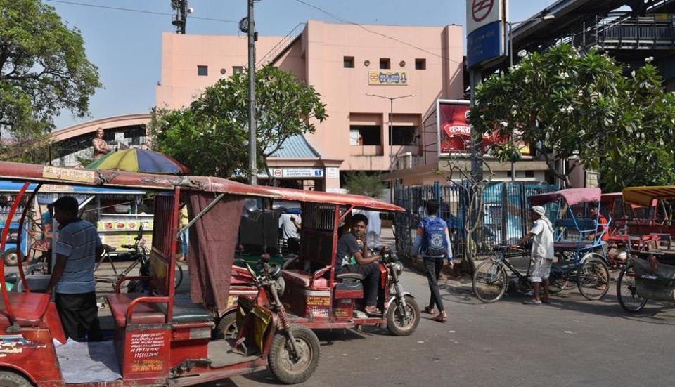 Encroachments and e-rickshaws in a no parking zone outside Ramakrishna Ashram Marg metro station in New Delhi.