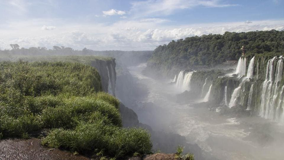 Overlooking Brazil from the precipice of Iguazu's Devil's Throat in Argentina.