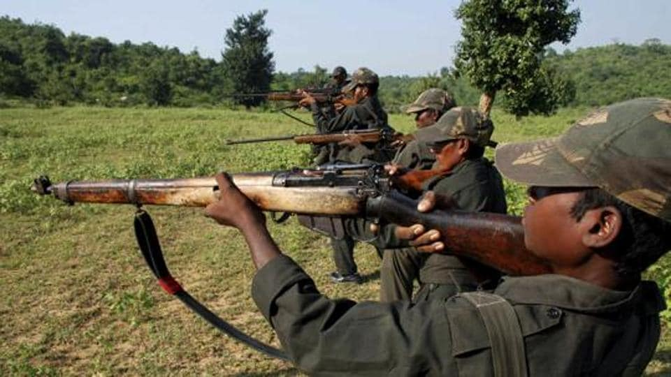Maoist rebels train in a forest area at Dumariya block in Gaya district, in Bihar