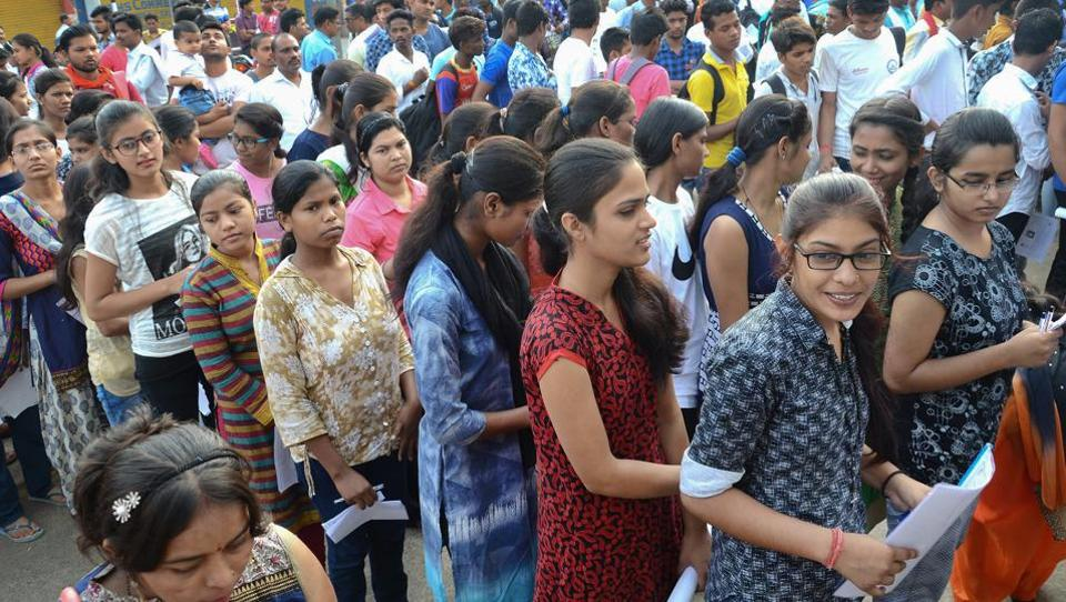 Applicants wait outside an examination centre to appear in the National Eligibility-Cum-Entrance Test  2018, in Jabalpur on Sunday.