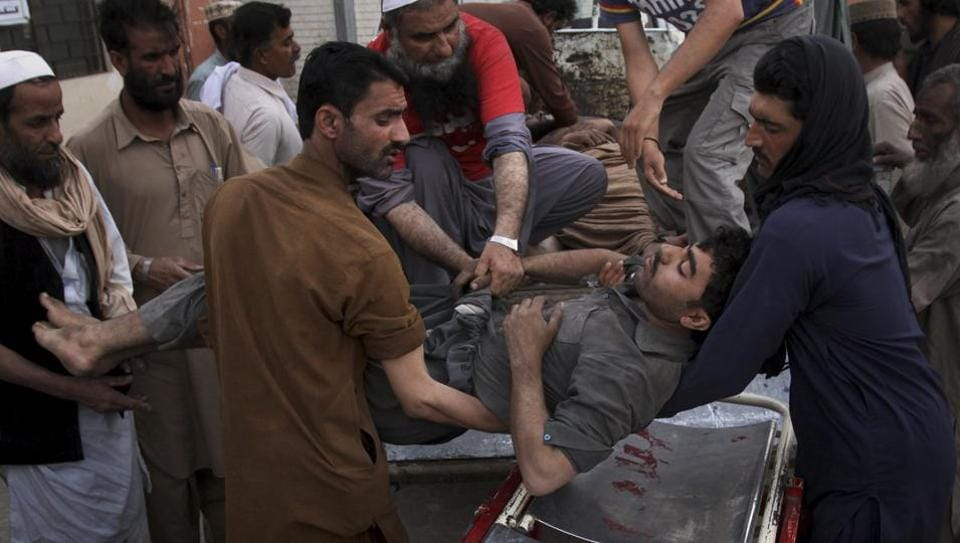 Pakistani volunteers and mine workers shift to their injured colleague on a stretcher upon arrival at a hospital in Quetta, Pakistan, Saturday, May 5, 2018.