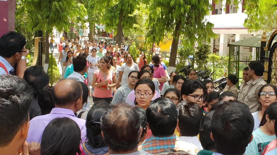 NEET aspirants come out of the exam centre in Kota on Sunday.