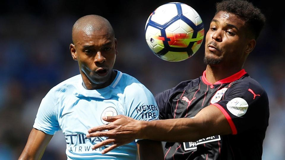 Huddersfield Town's Steve Mounie in action with Manchester City's Fernandinho during their Premier League match on Sunday.