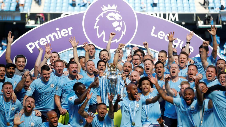 Manchester City lifted the Premier League trophy at the Etihad Stadium on Sunday following their goalless draw against Huddersfield Town. (REUTERS)