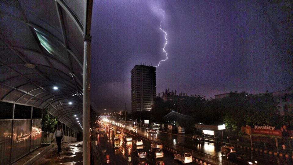 A view of lightening and sudden rain at ITO, New Delhi, India.