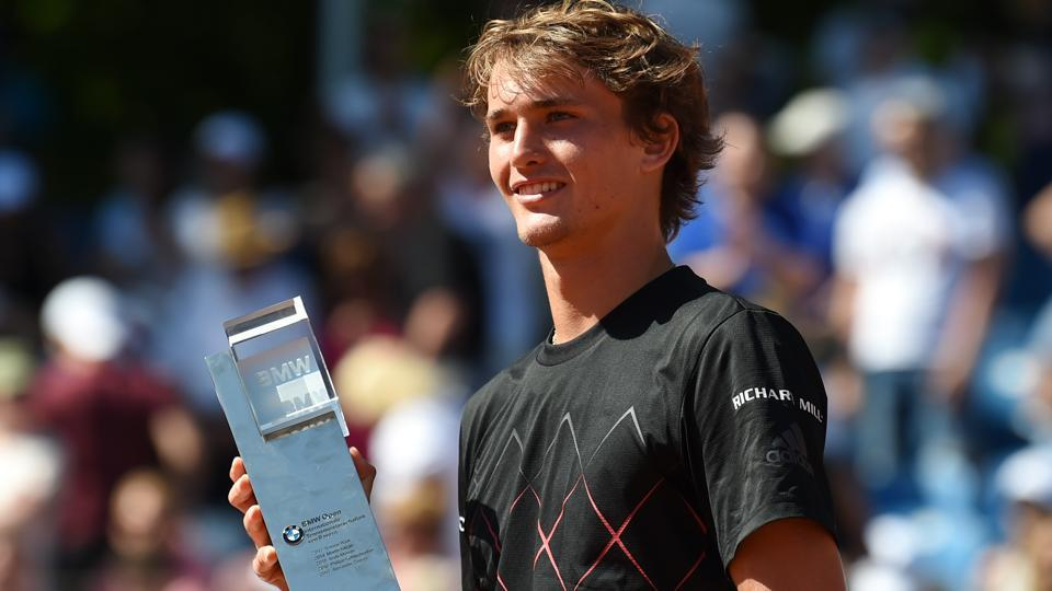 Alexander Zverev poses with the trophy after defeating his compatriot Philipp Kohlschreiber in the Munich Open final.