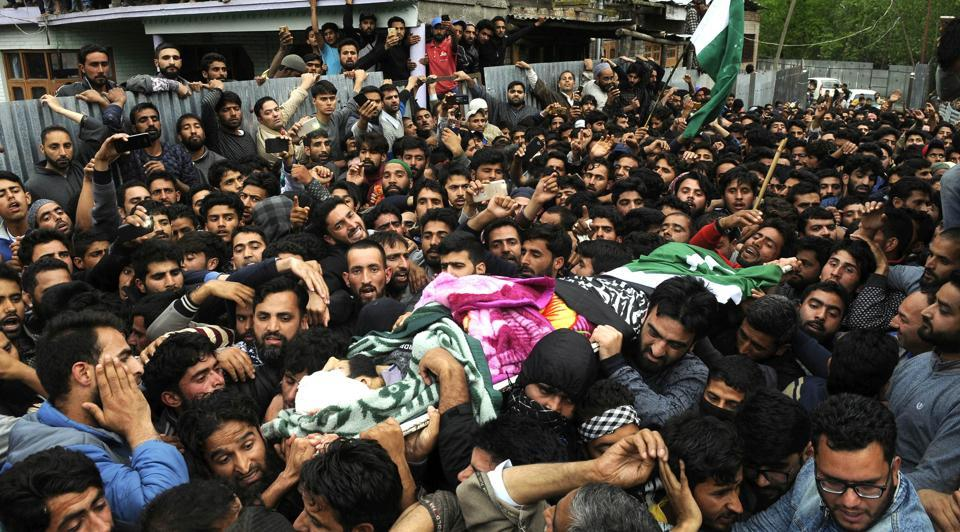 Villagers carry the body of deceased Mohammad Rafi Bhat an assistant professor during his funeral procession at his home district of Ganderbal in central Kashmir.