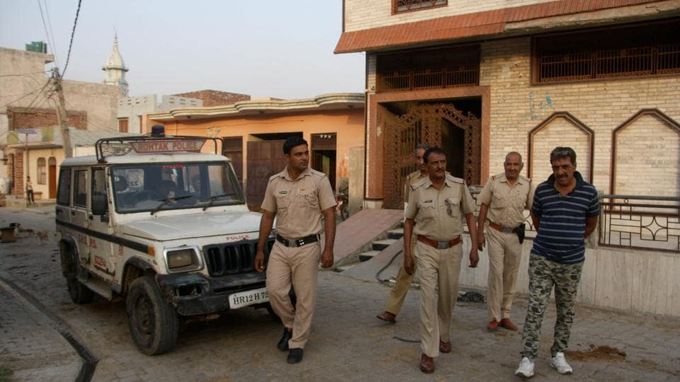 Police deployed outside house of Bhagwan brothers in Rohtak's Karor village on Saturday.
