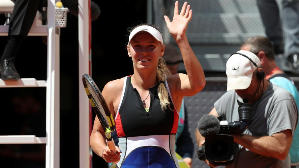 Denmark's Caroline Wozniacki celebrates winning her round of 64 match against Australia's Daria Gavrilova.