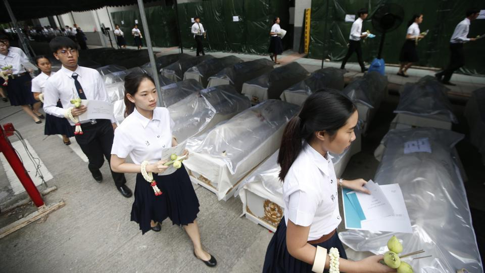Medical students arrive for a ceremony to pay respects to cadavers used in their studies at Chulalongkorn Hospital in Bangkok, Thailand. The students said prayers over the coffins of some 300 cadavers in a solemn ceremony to bid farewell to the corpses who helped them sharpen their dissection and anatomy knowledge. (Sakchai Lalit / AP)