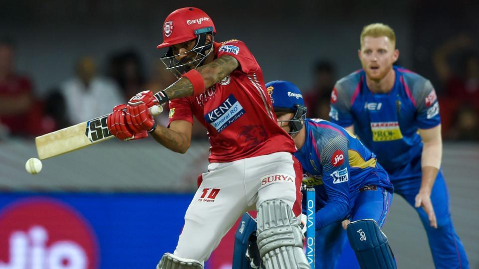 Kings XI Punjab's (KXIP's)KL Rahul hits a boundary as Rajasthan Royals' Jos Buttler (C) and Ben Stokes look on during the 2018 Indian Premier League (IPL 2018) match at the Holkar Cricket Stadium in Indore on Sunday.