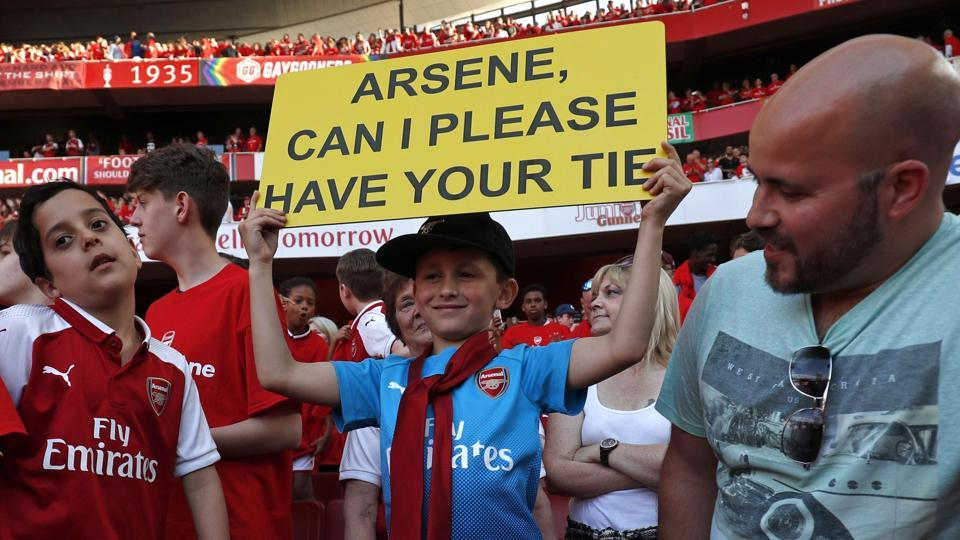 A young supporter, seven-year-old Luca Iacurti wears a tie which Arsenal's French manager Arsene Wenger was wearing after the English Premier League football match between Arsenal and Burnley at the Emirates Stadium in London on May 6, 2018.