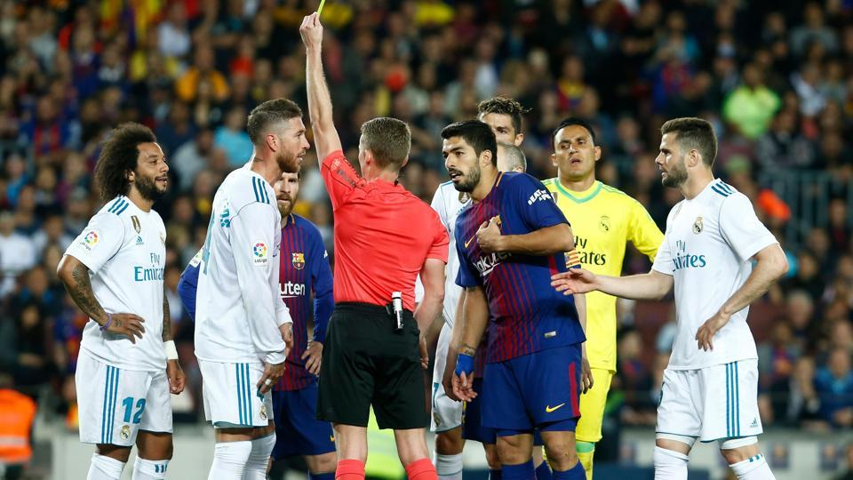 Real Madrid captain Sergio Ramos was among the eight players to be yellow carded in a feisty match between Real Madrid and Barcelona.