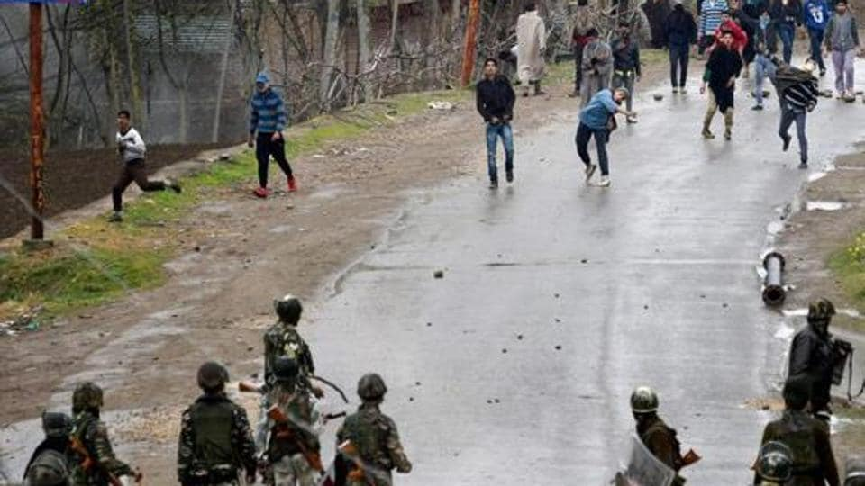 File photo of a group pelting stones at security forces in Budgam district in Kashmir.