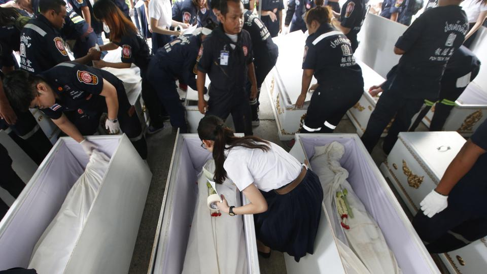 "Medical students and volunteers lay down garlands, paying respects to the cadavers. ""We don't really know the people, but for me, we are close... we spend a lot of time together,"" said 21-year-old Paspimol Kositchaiwat, who is in her second year of medical school at Bangkok's Chulalongkorn University.  (Sakchai Lalit / AP)"