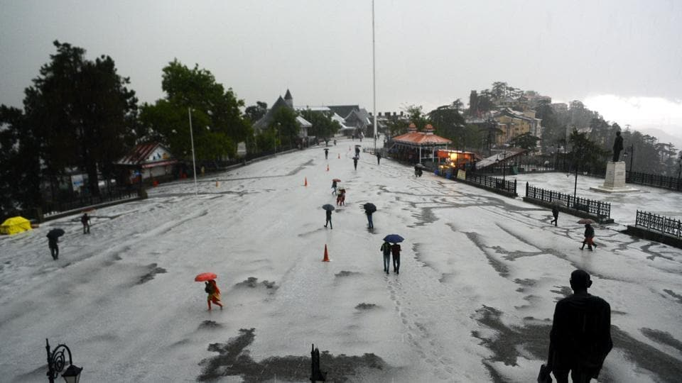 The roads were covered with a white carpet while gushing water flowed through narrow streets. (Deepak Sansta/HT)