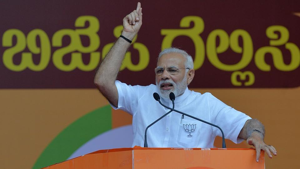 "Prime Minister Narendra Modi on Tuesday accused the Congress of pursuing the policy of ""divide and rule"", and asserted the party would be uprooted from Karnataka in the assembly elections. ""Congress believes in the policy of divide and rule... divide on the basis of caste and religion....make brother fight brother. But people of this land of Basaveshwara will not allow it to happen,"" he told an election rally in Vijayapura in Bijapur district. (Manjunath Kiran / AFP File)"