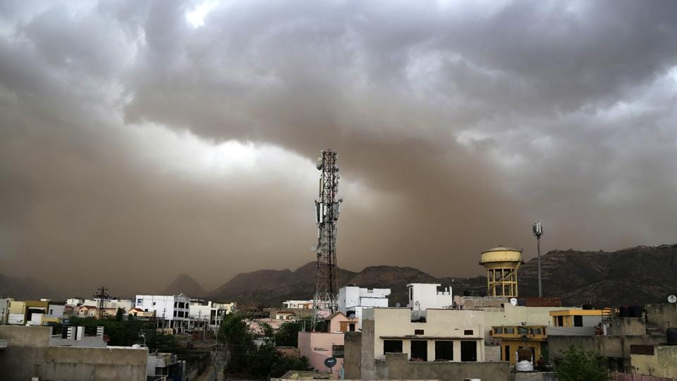 "A high-velocity dust storm hit parts of north India on Monday night with wind speeds of up to 70 kilometres per hour, the Met office said adding the squalls are likely to continue. ""The actual storm is expected to hit today towards afternoon and evening. We are expecting lightning, thunderstorm, rain and gusty winds that could reach up to 70 km per hour,"" said Kuldeep Srivastava, a senior scientist with the regional meteorological office. (Himanshu Sharma / AFP)"