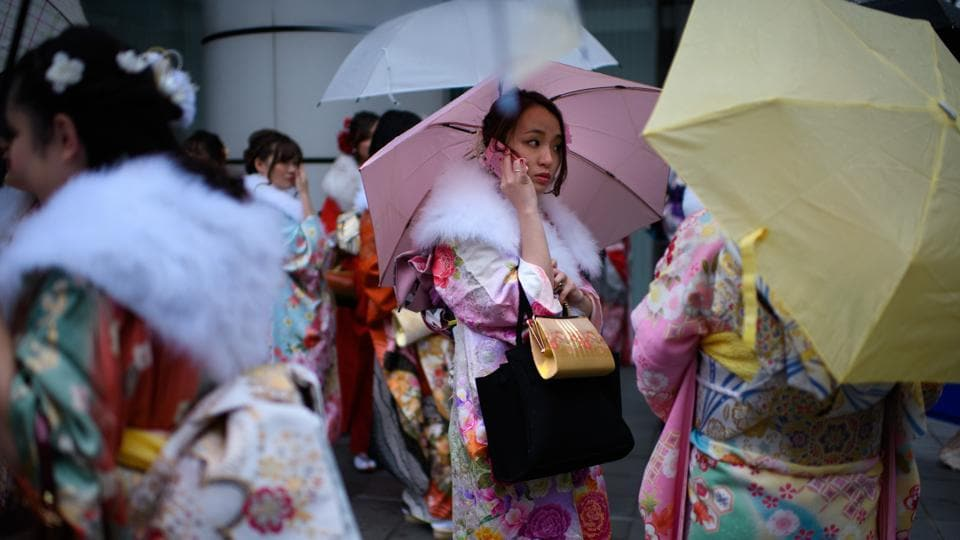 "Women wearing kimonos gather after attending the 'Coming of Age Day' ceremony in Yokohama, Japan. Yajima (not pictured) has nearly doubled his number of customers in the past 15 years by selling more kimonos under the 100,000-yen ($930) price tag, well below the many thousands of dollars a high-end piece can cost. ""The industry will grow if we can create a market in which as many people as possible will buy a kimono,"" he said. (Getty Images)"