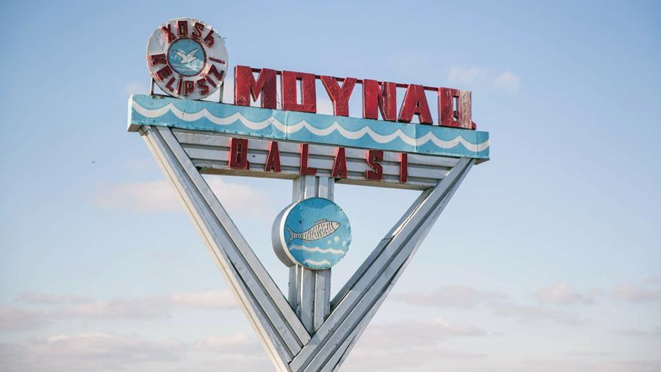 A sign for Moynaq stands at the entrance of the city. The Aral Sea is situated in Central Asia, between the Southern part of Kazakhstan and Northern Uzbekistan. Up until the third quarter of the 20th century it was the world's fourth largest saline lake. (Taylor Weidman / Bloomberg)