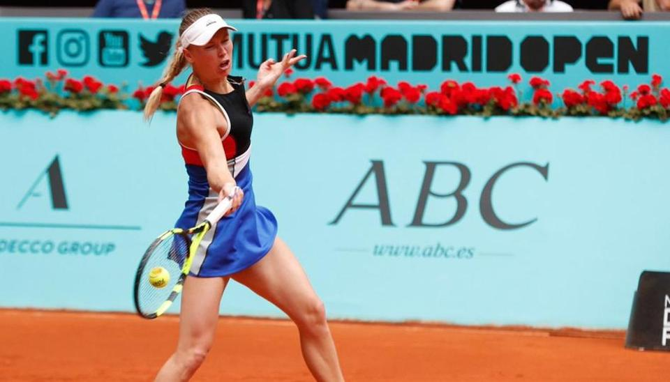 World number two Caroline Wozniacki was stunned by Kiki Bertens in the third round at the Madrid Open.