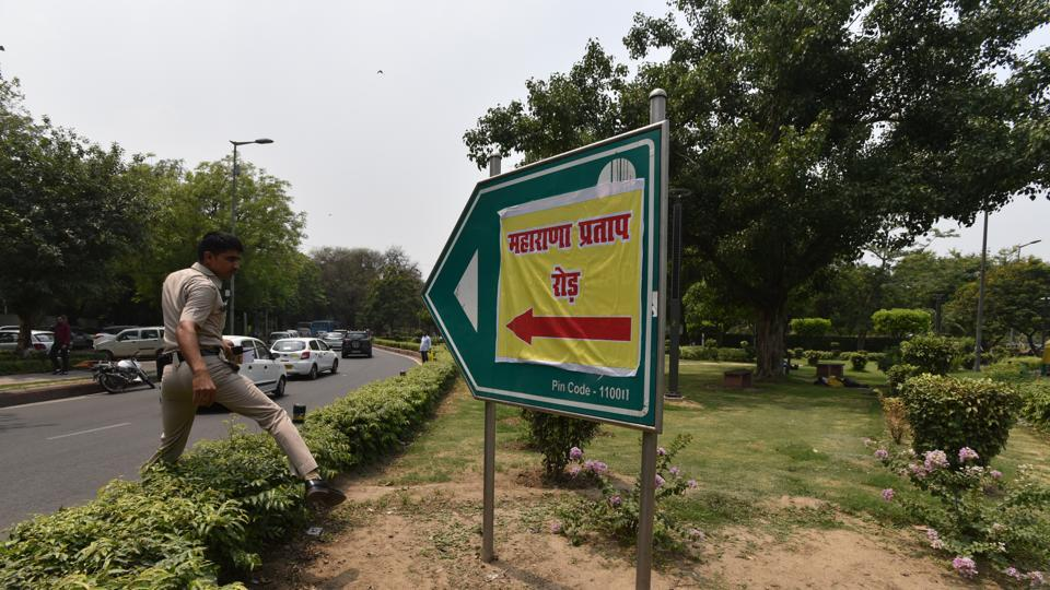 "A poster with 'Maharana Pratap Marg' written on it was found pasted on an Akbar Road signboard in Lutyens' Delhi today, with the police later removing it. ""No such proposal has been received by the council neither such a renaming has been approved. The defacement of the signboard is a law and order issue and the police should take the required action,"" an NDMC spokesperson said. (Anushree Fadnavis / HT Photo)"