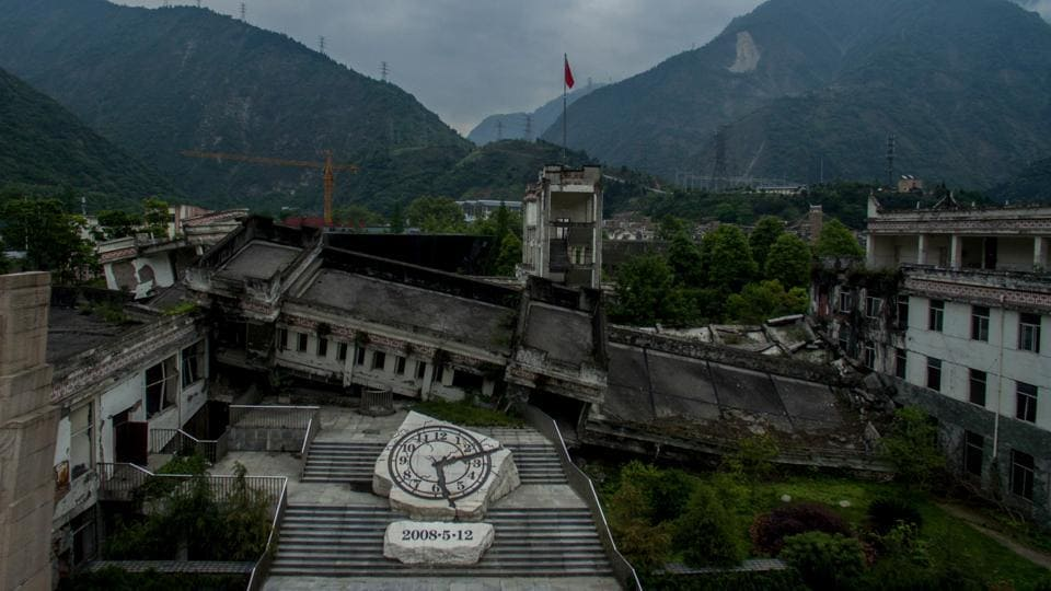 In the nearby town of Yingxiu is a giant clock stuck at the quake's time and date. Twenty guides relive their trauma for over 2.2 million tourists a year, shepherding them down the eerily quiet streets and through the rubble of their lives. Many more work to protect remaining structures and piles of debris from the elements, as a reminder of life's fleeting nature. (Johannes Eisele / AFP)