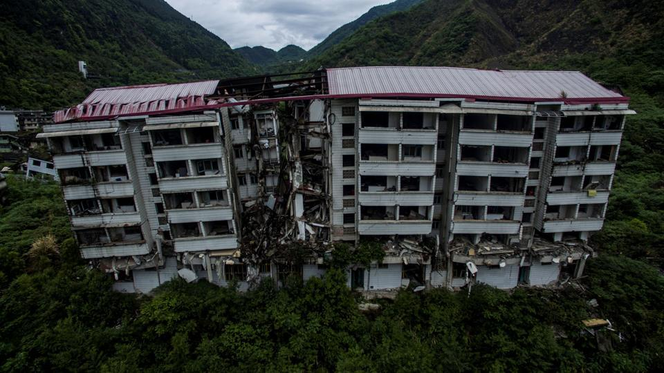 "In addition to the emotional challenges, Beichuan's preservation has faced financial and technical obstacles. ""The main difficulty we're facing is a financial problem,"" Chen said, adding that rain, wind and corrosion could eventually lead to the complete collapse of many buildings. The project is the largest of its kind, Chen said, and the city spends over 20 million yuan ($3.1 million) a year on its upkeep. (Johannes Eisele / AFP)"