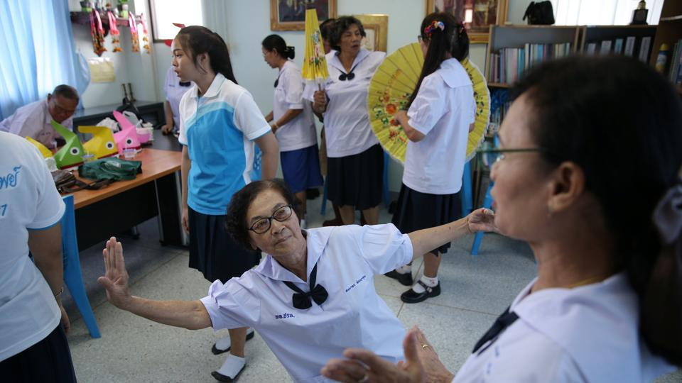 Students attend a traditional dance class at the School for the Elderly. Schools like the one in Ayutthaya, 80 km north of Bangkok, that offer weekly classes over three months are the government's way of offering older people relief from the stresses of living alone. (Athit Perawongmetha / REUTERS)
