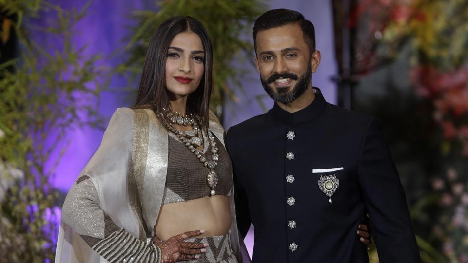Sonam Kapoor poses with husband Anand Ahuja at their wedding reception in Mumbai on Tuesday.