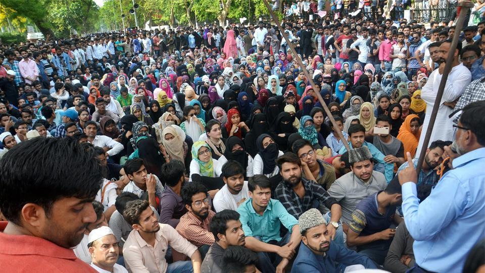 Aligarh Muslim University students stage a protest over the Jinnah portrait issue in Aligarh on Sunday.