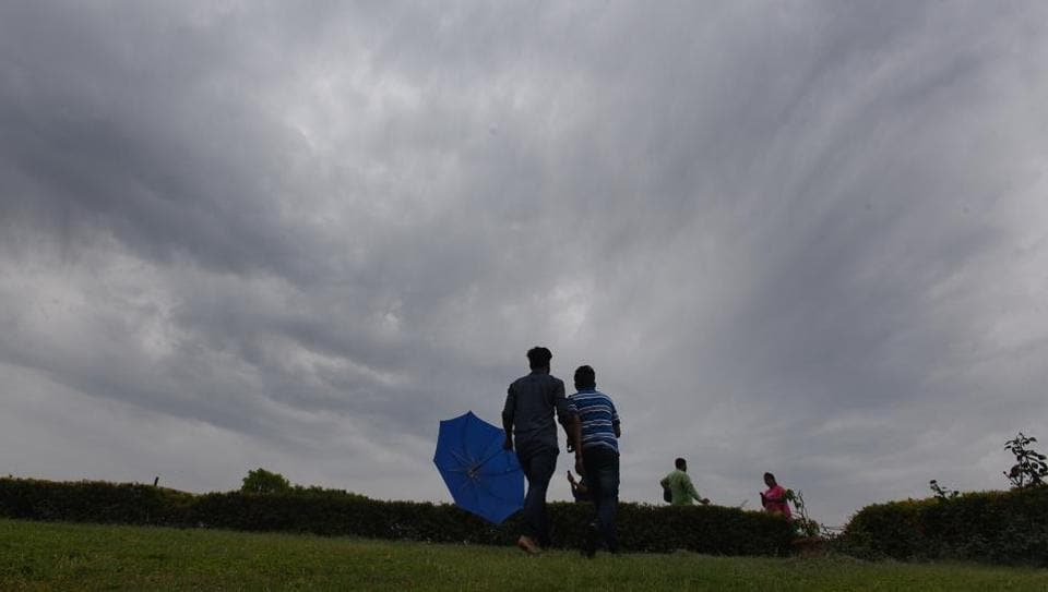 People enjoy the weather in New Delhi, India.