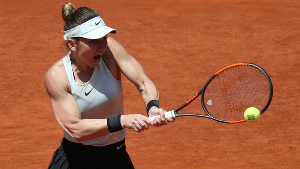 Simona Halep edged closer to a third consecutive Madrid Open title by beating Belgium's Elise Mertens in the second round on Tuesday.