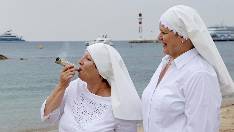 Sister Kate and Sister Claire pose on the beach to promote the documentary film 'Breaking Habits' at the 71st Cannes Film Festival in Cannes, France. (Regis Duvignau / REUTERS)