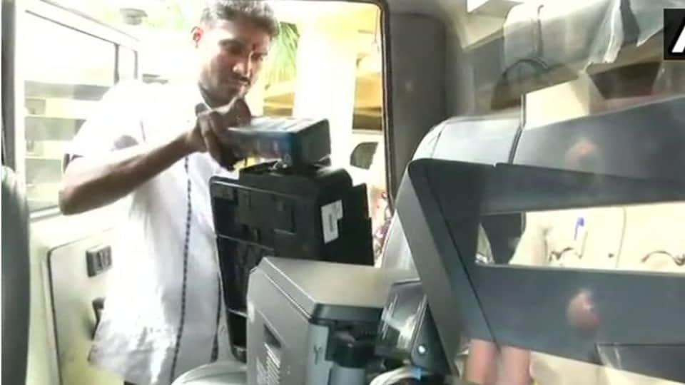 Election Commission officials seize printers from a flat at SLV Park View Apartment in Jalahalli area where 9,746 voter ID cards were found on Tuesday night.