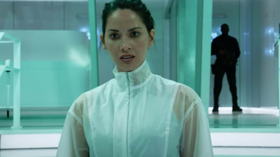Olivia Munn stars as a scientist who must help elite soldiers against the Predators.