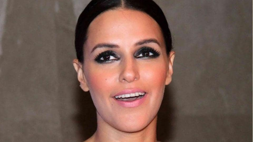 Are you a bride that simply wants to look like herself? See Neha Dhupia's comfy Mehendi outfit for inspiration. (IANS File Photo)