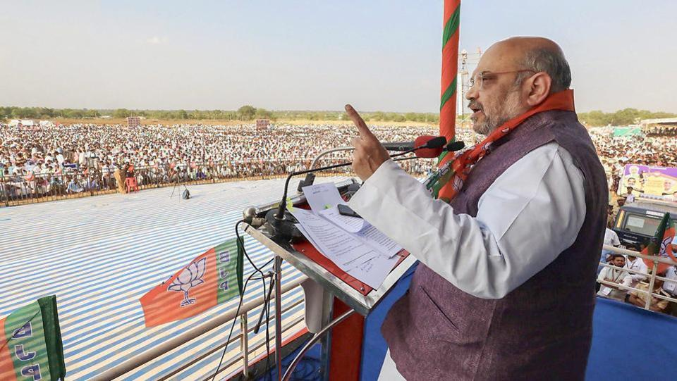 BJP National President Amit Shah addresses the OBC Convention during his fifth round of campaigning in Kaginele, Karnataka on April 03, 2018. Speaking at the convention, Shah promised to ensure the passage of the bill granting constitutional status to the National Commission for Backward Classes in Parliament. (PTI)