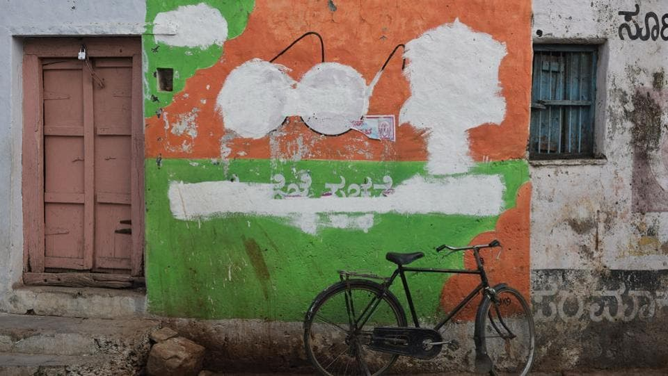 A not so 'swachh'  wall mural after the authorities were done with this Swachh Bharat Abhiyan advertisement in the state's Kalburgi district. (Arijit Sen / HT Photo)