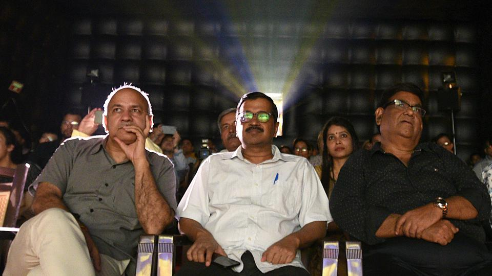 "Delhi Chief Minister Arvind Kejriwal (C) along with Deputy CM Manish Sisodia (L) watch a movie ""A Billion Colour Story"" co-produced by  filmmaker Satish Kaushik (R) during the inauguration of a mobile digital movie theatre at Indira Gandhi National Centre in New Delhi on May 09, 2018. (Raj K Raj / HT Photo)"