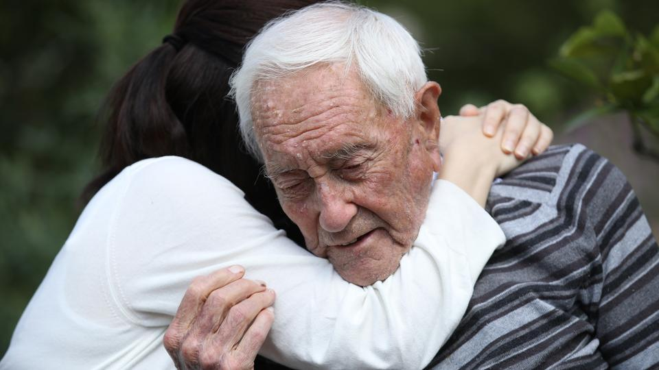 Australian botanist and academic David Goodall, who is 104 years old, gets a hug from Taiwanese actress and television hostess Bowie Tsang during the filming of a documentary film at the Basel University Botanical Gardens the day before his planned assisted suicide in Basel, Switzerland. (Sean Gallup / Getty Images)
